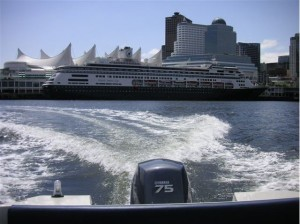 17ft rental boat with one of many cruise ships visiting Vancouver