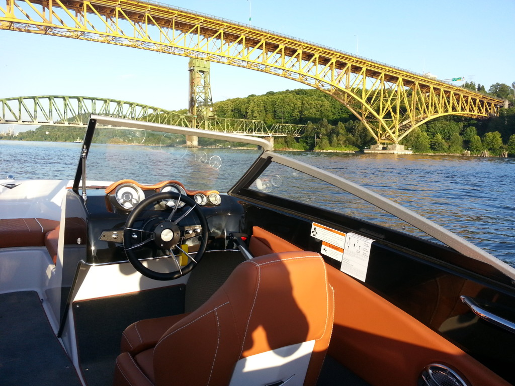 18ft boat at Second Narrows bridge at sunset