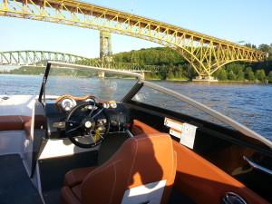 18ft boat at Second Narrows bridge at sunset