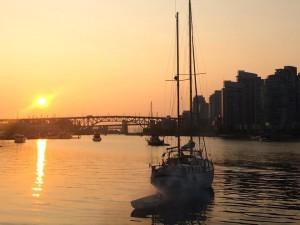 Boats in false creek at sunset