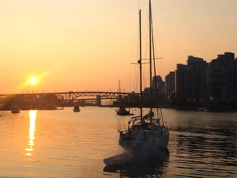 Boats in false creek at sunset