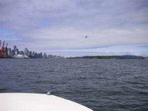 Hourston Glasscraft boat watching Float Plane Landing in Coal Harbour